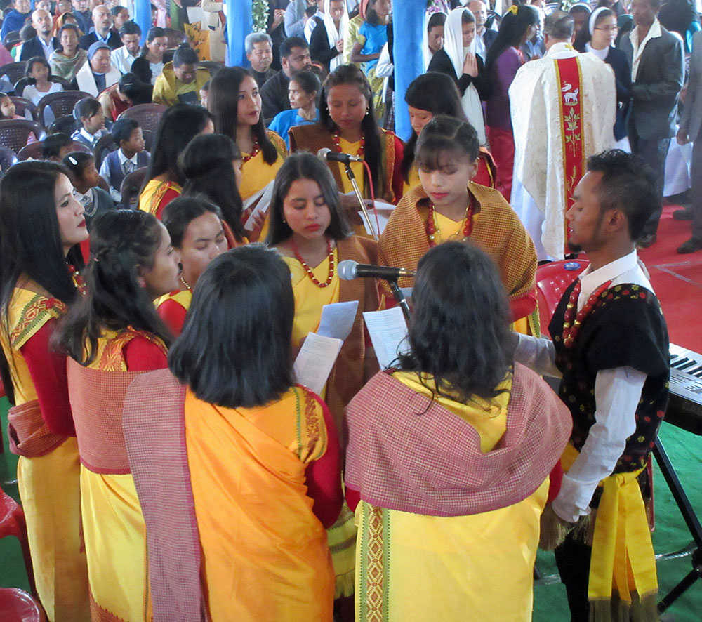 The colourful choir during mass in Umbir